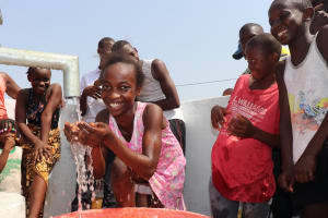 The Water Project: Lungi, Thomossoh, #24 Thullah Street -  Small Girl Drinks From The Well