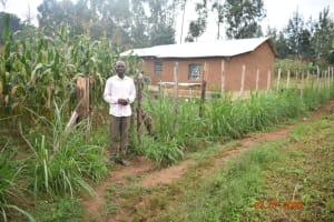 The Water Project: Emukoyani Community, Ombalasi Spring -  Niskson Sakwa Shivuka Outside His Homestead