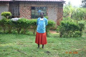 The Water Project: Ataku Community, Ngache Spring -  Catherine Waka Outside Her Home