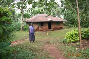 The Water Project: Emulembo Community, Gideon Spring -  Everlyne Muruli Outside Her Home