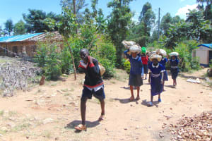 The Water Project: Mutiva Primary School -  Students Carrying Sand To Construction Site