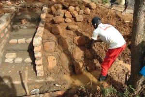 The Water Project: Ewamakhumbi Community, Mukungu Spring -  Stone Pitching