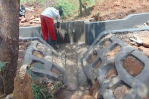 The Water Project: Ewamakhumbi Community, Mukungu Spring -  Outside Plastering