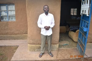 The Water Project: Emukoyani Community, Ombalasi Spring -  Niskson Sakwa Shivuka Outside His Home