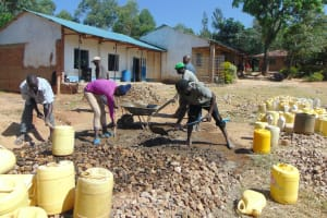 The Water Project: Mutiva Primary School -  Mixing Gravel Sand And Cement