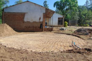 The Water Project: Mutiva Primary School -  Foundation Covered With Stones Gravel And Sand