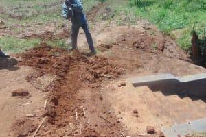 The Water Project: Ewamakhumbi Community, Mukungu Spring -  Cut Off Drainage Digging