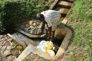 The Water Project: Mungakha Community, Nyanje Spring -  Patrick Fetching Water From Nyanje Spring