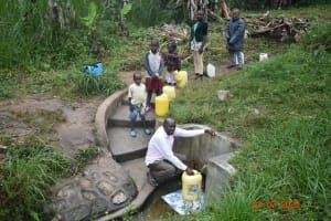 The Water Project: Emukoyani Community, Ombalasi Spring -  Niskson And Others At The Spring