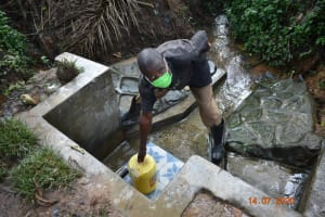 The Water Project: Mungakha Community, Asena Spring -  Philip Fetches Water From Asena Spring