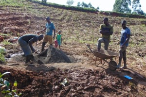 The Water Project: Ewamakhumbi Community, Mukungu Spring -  Mixing Cement