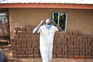 The Water Project: Mungakha Community, Nyanje Spring -  Patrick Puts On His Mask