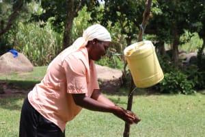 The Water Project: Mahira Community, Litinyi Spring -  Handwashing Using The Leaky Tin