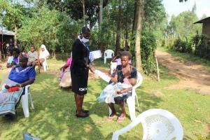 The Water Project: Bukhunyilu Community, Solomon Wangula Spring -  Distributing Handouts At The Training