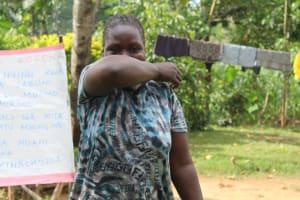 The Water Project: Bukhunyilu Community, Solomon Wangula Spring -  Elbow Cough