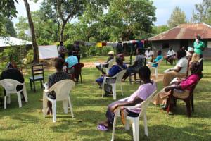 The Water Project: Bukhunyilu Community, Solomon Wangula Spring -  Using Reminder Chart