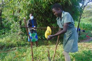 The Water Project: Shihingo Community, Mulambala Spring -  A Girl Washing Her Hands