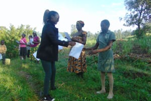 The Water Project: Shihingo Community, Mulambala Spring -  Ms Olivia Issuing The Handouts