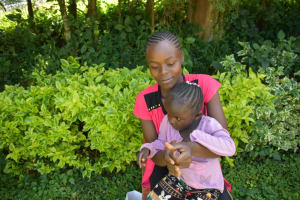 The Water Project: Ivulugulu Community, Ishangwela Spring -  Community Members Practicing The Handwashing Steps