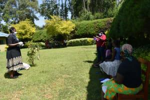 The Water Project: Ivulugulu Community, Ishangwela Spring -  Demonstration On Mask Making