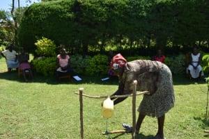 The Water Project: Ivulugulu Community, Ishangwela Spring -  Handwashing At Simple Setup Handwashing Point