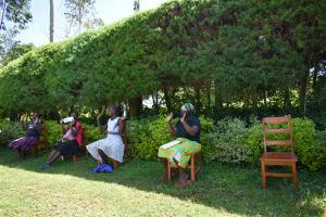 The Water Project: Ivulugulu Community, Ishangwela Spring -  New Greetings Norm In Kenya