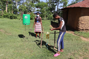 The Water Project: Musango Community, Dawi Spring -  A Community Member Washing Her Hands