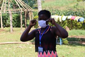 The Water Project: Mwituwa Community, Shikunyi Spring -  Proper Mask Wearing Illustration