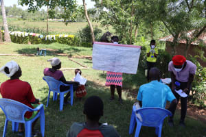 The Water Project: Mwituwa Community, Shikunyi Spring -  Using Reminder Chart At The Training