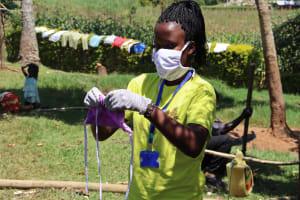 The Water Project: Mwituwa Community, Shikunyi Spring -  Sewing A Mask