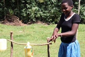 The Water Project: Mwituwa Community, Nanjira Spring -  A Community Member Following Handwashing Steps