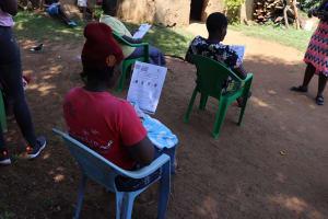 The Water Project: Mwituwa Community, Nanjira Spring -  Participants Following Training Using Handouts