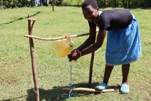 The Water Project: Mwituwa Community, Nanjira Spring -  Using Installed Handwashing Point