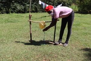 The Water Project: Mwituwa Community, Nanjira Spring -  Demonstration On Using The Installed Handwashing Station