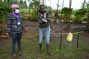 The Water Project: Burachu B Community, Shitende Spring -  Practicing Handwashing