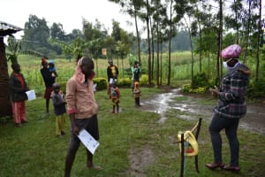 The Water Project: Burachu B Community, Shitende Spring -  Training On Using Handwashing Station