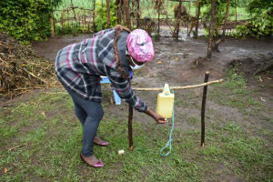The Water Project: Burachu B Community, Shitende Spring -  Using Handwashing Station