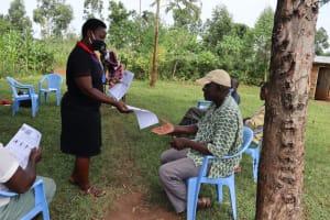 The Water Project: Ataku Community, Ataku Spring -  Ms Betty Handing Out The Training Aids