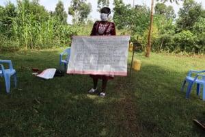 The Water Project: Ataku Community, Ataku Spring -  Ms Wagaka Holding Up The Chart