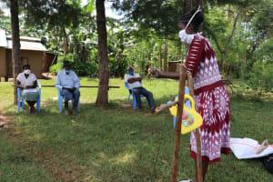 The Water Project: Ataku Community, Ataku Spring -  Ms Wagaka Leading A Handwashing Demonstration