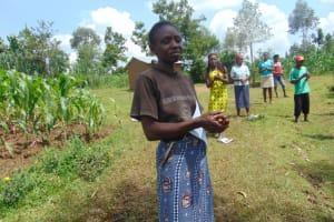The Water Project: Handidi Community, Chisembe Spring -  A Woman Closely Follows The Ten Handwashing Steps
