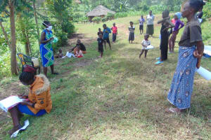 The Water Project: Handidi Community, Chisembe Spring -  Community Members Listening In Closely