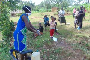 The Water Project: Handidi Community, Chisembe Spring -  Ms Wagaka Leading Handwashing Training