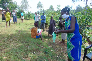 The Water Project: Handidi Community, Chisembe Spring -  Demonstrating How To Make A Mask