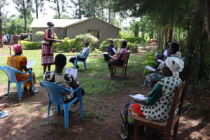 The Water Project: Musiachi Community, Thomas Spring -  Community Members Listening To The Facilitator
