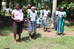 The Water Project: Musiachi Community, Thomas Spring -  Group Photo With Pamphlets After Covid Training
