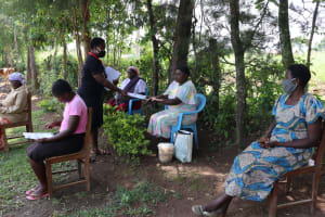 The Water Project: Musiachi Community, Thomas Spring -  Ms Betty Issuing Covid Pamphlets