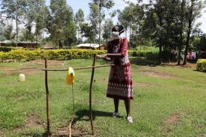The Water Project: Musiachi Community, Thomas Spring -  The Facilitator Demonstrating Handwashing