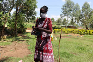 The Water Project: Musiachi Community, Thomas Spring -  Demonstrating How To Make A Simple Mask