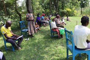 The Water Project: Muyundi Community, Baraza Spring -  A Community Member Addressing The Group